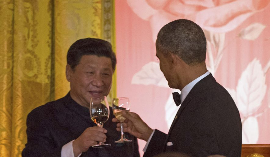 Chinese President Xi Jinping and President Obama toast during a state dinner Friday at the White House. (AP Photo)