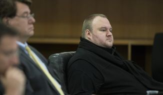 Kim Dotcom sits in the Auckland District Court during an extradition hearing in Auckland, New Zealand, in this Sept. 21, 2015, file photo. The much-delayed extradition hearing for Doctom and three others who owned or helped run the website Megaupload began in Auckland this week in a case that could have broader implications for Internet copyright rules. (Jason Oxenham/New Zealand Herald via AP, File)