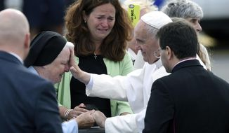 Pope Francis stops to meet people after arriving at Philadelphia International Airport in Philadelphia, Saturday, Sept. 26, 2015. The Pope will spend the last two of his six days in the U.S. in Philadelphia as the star attraction at the World Meeting of Families, a conference for more than 18,000 people from around the world that has been underway as the pope traveled to Washington and New York. (AP Photo/Susan Walsh)