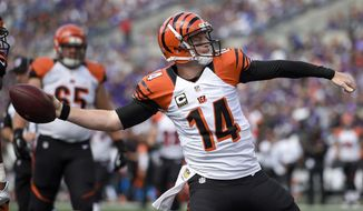 Cincinnati Bengals quarterback Andy Dalton (14) spikes the ball after scoring a touchdown on a quarterback keeper during the first half of an NFL football game against the Baltimore Ravens in Baltimore, Sunday, Sept. 27, 2015. (AP Photo/Nick Wass)
