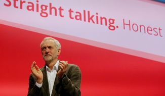 Britain's Labour party leader, Jeremy Corbyn, applauds during the party's annual conference in Brighton, southern England, Sunday Sept. 27, 2015. (Gareth Fuller/PA Via AP)  UNITED KINGDOM OUT  NO SALES  NO ARCHIVE