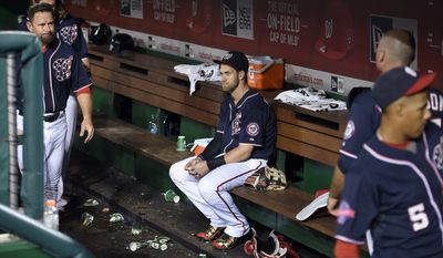 Washington Nationals' Bryce Harper center, sits in the dugout after a baseball game against the Philadelphia Phillies, Friday, Sept. 25, 2015, in Washington. The Phillies won 8-2. (AP Photo/Nick Wass)