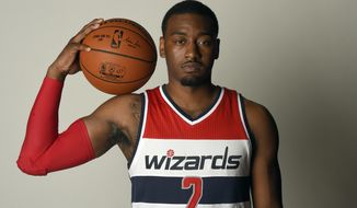 Washington Wizards' John Wall poses for a photograph during an NBA basketball media day, Monday, Sept. 28, 2015, in Washington. (AP Photo/Nick Wass)