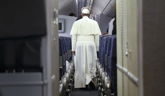 Pope Francis walks aboard the papal plane while en route to Italy, Monday, Sept. 28, 2015.  Pope Francis returned to the Vatican Monday at the end of a 10-day trip to Cuba and the United States. (Tony Gentile/Pool Photo via AP)