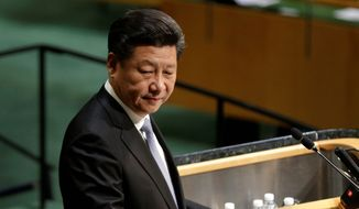 Chinese President Xi Jinping said his country will give $1 billion toward U.N. peacekeeping efforts, including those in Syria. (Associated Press) **FILE**
