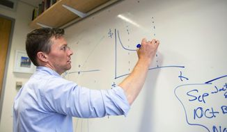 In this Sept. 10, 2015 file photo provided by the John D. and Catherine T. MacArthur Foundation, urban sociologist Matthew Desmond draws a chart on a whiteboard in his office at Harvard University in Cambridge, Mass.  On Feb. 20, the Detroit News and the Lansing State Journal reported that Michigan State University was banning the use of whiteboards on dorm-room doors starting in the fall 2017 semester, citing a rise in incidents of offensive language being scrawled on the dry-erase tablets. (John D. and Catherine T. MacArthur Foundation via AP) **FILE**