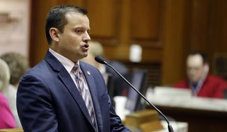 In this Feb. 9, 2015, file photo, Rep. Jud McMillin, R-Brookville, presents a bill at the Statehouse in Indianapolis. House Republicans announced Tuesday, Sept. 29, that McMillin was resigning from the Legislature. (AP Photo/Michael Conroy, File)