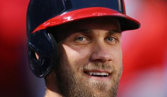 Washington Nationals Bryce Harper smiles as he takes the field to bat against the Atlanta Braves during the first inning in a baseball game on Monday, Sept. 29, 2015, in Atlanta. (Curtis Compton/Atlanta Journal-Constitution via AP)  MARIETTA DAILY OUT; GWINNETT DAILY POST OUT; LOCAL TELEVISION OUT; WXIA-TV OUT; WGCL-TV OUT; MANDATORY CREDIT