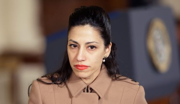 Huma Abedin, long-time aide of former Secretary of State Hillary Rodham Clinton, was paid by a private firm to help stage an event with former President Bill Clinton. (Associated Press)