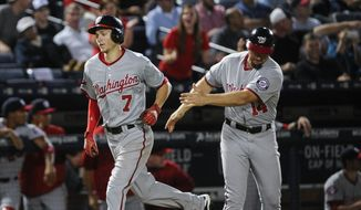 Washington Nationals' Trea Turner (7) is congratulated by coach Bob Henley as he rounds third base on a home run during the sixth inning of a baseball game, Tuesday, Sept. 29, 2015, in Atlanta. (AP Photo/John Amis)
