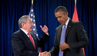 President Obama shakes hands with Cuban President Raul Castro in front of members of the media before a bilateral meeting Sept. 29, 2015, at the United Nations headquarters. (Associated Press) ** FILE **