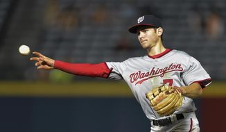 Washington Nationals second baseman Trea Turner (7) throws to first base for an out on Atlanta Braves' Nick Swisher during the third inning of a baseball game, Wednesday, Sept. 30, 2015, in Atlanta. (AP Photo/Jon Barash) **FILE**