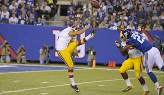 New York Giants' Rashad Jennings (23) blocks a punt by Washington Redskins punter Tress Way (5) during the first half an NFL football game Thursday Sept. 24, 2015, in East Rutherford, N.J. (AP Photo/Bill Kostroun)