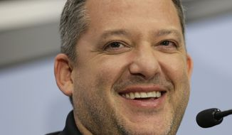 Tony Stewart smiles as he answers a question during a news conference to announce his retirement from driving NASCAR Sprint Cup series racing after the 2016 season at Stewart-Haas Racing's headquarters in Kannapolis, N.C., Wednesday, Sept. 30, 2015. (AP Photo/Chuck Burton)