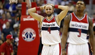 Washington Wizards center Marcin Gortat (4), from Poland, reacts in the second half of Game 4 of the second round of the NBA basketball playoffs against the Atlanta Hawks Monday, May 11, 2015, in Washington. The Hawks won 106-101. (AP Photo/Alex Brandon)