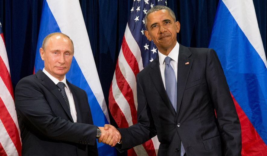 United States President Barack Obama, right, and Russia's President President Vladimir Putin pose for members of the media before a bilateral meeting Monday, Sept. 28, 2015, at United Nations headquarters. (AP Photo/Andrew Harnik)