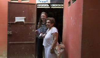 In this July 28, 2015, file photo, Chelsea Clinton, left, poses for a picture with Donna Shalala, Clinton Foundation president, at Papillon Enterprise, in Port-au-Prince, Haiti. Former President Bill Clinton and his daughter Chelsea Clinton issued a statement saying Shalala was stricken Tuesday, Sept. 29, following a meeting of the Clinton Global Initiative, in New York. (AP Photo/Dieu Nalio Chery, File)