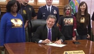 "Kansas Gov. Sam Brownback signed a proclamation Wednesday officially making October ""Zombie Preparedness Month,"" as a fun way to get Kansans ready for natural disasters. (Facebook/@Kansas Division of Emergency Management)"