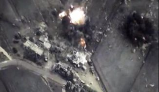 In this photo made from the footage taken from Russian Defense Ministry official web site on Thursday, Oct. 1, 2015, a bomb explosion is seen in Syria. Reacting to criticism that it is targeting opponents of the Syrian government, a spokesman for Russian President Vladimir Putin admitted on Thursday that Russia's airstrikes in Syria are targeting not only Islamic State militants but also other groups. (AP Photo/ Russian Defense Ministry Press Service)