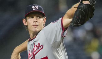 Washington Nationals' Stephen Strasburg pitches against the Atlanta Braves during the first inning of a baseball game, Thursday, Oct. 1, 2015, in Atlanta. (AP Photo/John Amis)