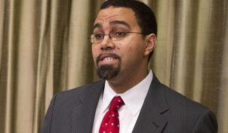 In this April 10, 2014 photo, John King Jr. speaks to students at New York University's Wagner School in New York. Education Secretary Arne Duncan is stepping down in December after 7 years in the Obama administration. President Barack Obama is tapping Education Department official John King Jr. to run the department in an acting capacity for the remainder of his presidency. But Obama is not nominating King to be the secretary.  (AP Photo/Michael Sisak, File)