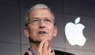 Apple CEO Tim Cook responds to a question during a news conference at IBM Watson headquarters, in New York, in this April 30, 2015, file photo. (AP Photo/Richard Drew, File)