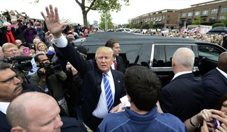 Republican presidential candidate Donald Trump waves to supporters as he leaves an event, Saturday, Oct. 3, 2015, in Franklin, Tenn. (AP Photo/Mark Zaleski)