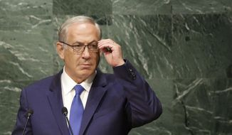 Israel's Prime Minister Benjamin Netanyahu looks at the audience before speaking during the 70th session of the United Nations General Assembly at U.N. headquarters, Thursday, Oct. 1, 2015. (AP Photo/Seth Wenig)