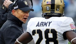 Army head coach Jeff Monken, left, talks with cornerback Brandon Jackson (28) during a timeout in the first half of an NCAA college football game against Penn State in State College, Pa., Saturday, Oct. 3, 2015. (AP Photo/Gene J. Puskar)