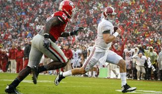 Alabama quarterback Jake Coker, right, out runs Georgia defensive tackle Sterling Bailey (58) to score a touchdown in the second half of an NCAA college football game  Saturday, Oct. 3, 2015, in Athens, Ga. Alabama won 38-10. (AP Photo/Brett Davis)