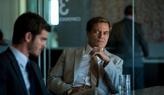 "In this image released by Broad Green Pictures, Andrew Garfield portrays Dennis Nash, left, and Michael Shannon portrays Rick Carver in a scene from ""99 Homes."" (Hooman Bahrani/Broad Green Pictures via AP)"
