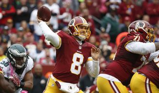 Washington Redskins quarterback Kirk Cousins (8) passes the ball during the first half of an NFL football game against the Philadelphia Eagles in Landover, Md., Sunday, Oct. 4, 2015. (AP Photo/Alex Brandon)