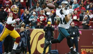 Philadelphia Eagles wide receiver Riley Cooper (14) pulls in a touchdown pass as Washington Redskins cornerback Chris Culliver (29) chases him during the second half of an NFL football game in Landover, Md., Sunday, Oct. 4, 2015. (AP Photo/Alex Brandon)