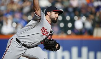 Washington Nationals starting pitcher Tanner Roark delivers in the second inning of a baseball game against the New York Mets in New York, Sunday, Oct. 4, 2015. (AP Photo/Kathy Willens)