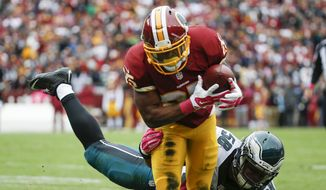 Washington Redskins running back Chris Thompson (25) is stopped short of the goal line by Philadelphia Eagles outside linebacker Jordan Hicks (58) during the first half of an NFL football game in Landover, Md., Sunday, Oct. 4, 2015. (AP Photo/Alex Brandon)