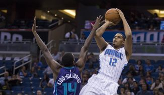 Orlando Magic forward Tobias Harris (12) shoots over Charlotte Hornets forward Michael Kidd-Gilchrist (14) during the first half of an NBA basketball game in Orlando, Fla., Saturday, Oct. 3, 2015. (AP Photo/Willie J. Allen Jr.)