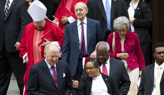 U.S. Supreme Court Justices Anthony M. Kennedy, left, Stephen Breyer, center, and Clarence Thomas, leave St. Matthews Cathedral, after the Red Mass in Washington on Sunday, Oct. 4, 2015. The Supreme Court's new term starts Monday, Oct. 5. ( AP Photo/Jose Luis Magana)