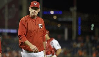 Washington Nationals manager Matt Williams walks to the dugout during the ninth inning of an interleague baseball game, Wednesday, Sept. 23, 2015, in Washington. Washington Nationals relief pitcher Jonathan Papelbon was ejected for hitting batter Baltimore Orioles' Manny Machado. The Orioles won 4-3. (AP Photo/Nick Wass)