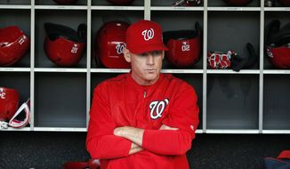 Washington Nationals manager Matt Williams (9) pauses in the dugout before a baseball game against the Philadelphia Phillies at Nationals Park, Friday, May 22, 2015, in Washington. (AP Photo/Alex Brandon)