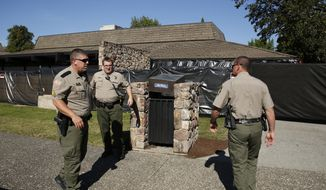 Sheriff's deputies stand in front of Snyder Hall at Umpqua Community College, Monday, Oct. 5, 2015, in Roseburg, Ore. The campus reopened on a limited basis for faculty and students for the first time since armed suspect Chris Harper-Mercer killed multiple people and wounded several others on Thursday before taking his own life at Snyder Hall. (AP Photo/John Locher)
