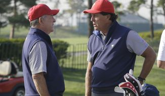 United States team captain Jay Haas, left, talks with his team player Phil Mickelson during a practice round ahead of the Presidents Cup golf tournament at Jack Nicklaus Golf Club Korea in Incheon, South Korea, Tuesday, Oct. 6, 2015. (AP Photo/Ahn Young-joon)