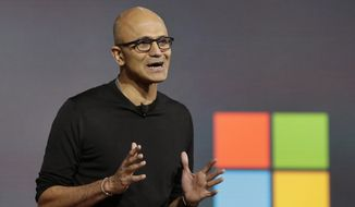 Microsoft CEO Satya Nadella closes a presentation of new devices, in New York, Tuesday, Oct. 6, 2015. (AP Photo/Richard Drew) ** FILE **