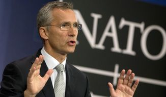NATO Secretary General Jens Stoltenberg speaks during a media conference at NATO headquarters in Brussels on Tuesday, Oct. 6, 2015. (AP Photo/Virginia Mayo)