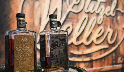 In this photo provided by Neiman Marcus, two bottles of bourbon available for tasting represent the $125,000 Orphaned Barrel Project gift during the launch of the Neiman Marcus Christmas Book, Tuesday, Oct. 6, 2015 in Dallas. (Tim Sharp/Neiman Marcus via AP)