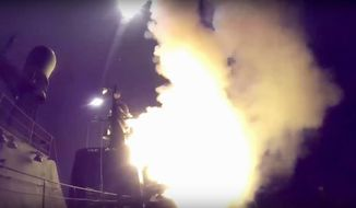 Russian naval ships launched cruise missiles Wednesday as President Vladimir Putin's military bombarded parts of Syria by air, land and sea, claiming Islamic State militants were the targets. (Associated Press)