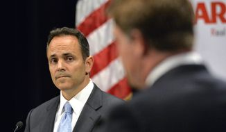Kentucky Republican gubernatorial candidate Matt Bevin, left, listens to a reply from his opponent, Democratic candidate Jack Conway during the 2015 Kentucky Gubernatorial Debate hosted by Centre College, Tuesday, Oct. 6, 2015, in Danville, Ky. (AP Photo/Timothy D. Easley)