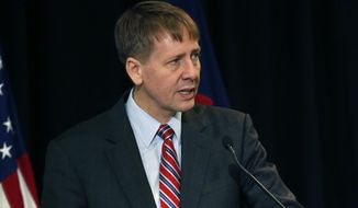 Consumer Financial Protection Bureau Director Richard Cordray speaks during a a hearing in Denver where he discussed his agency's proposal on arbitration, in Denver, Colo., Wednesday, Oct. 7, 2015. If enacted, the plan would severely curtail a contentious practice called mandatory arbitration, which consumer advocates have long argued does a disservice to people who have disputes with banks, credit card issuers and other financial service providers. (AP Photo/Brennan Linsley) **FILE**