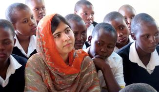 "This May 26, 2014 photo provided by courtesy of Fox Searchlight Pictures shows, Malala Yousafzai, second left, at the Kisaruni Girls School in Massai Mara, Kenya. Yousafzai is the subject of the documentary film, ""He Named Me Malala."" (Fox Searchlight Pictures via AP)"