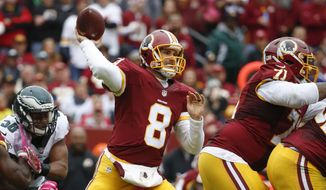 In  this photo taken Oct. 4, 2015, Washington Redskins quarterback Kirk Cousins (8) passes the ball during the first half of an NFL football game against the Philadelphia Eagles in Landover, Md. Kirk Cousins proved to himself, his head coach and his teammates that he can direct a game-winning drive. Now the question is: Can he do it again?  (AP Photo/Alex Brandon)
