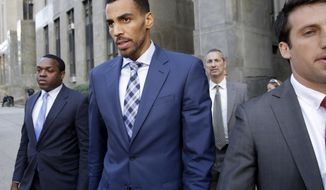 Thabo Sefolosha, second from left, leaves criminal court in New York, Wednesday, Oct. 7, 2015. The professional basketball player was about to give a handout to a man asking for money when police officers took him to the ground and arrested him, a former teammate testified Wednesday. (AP Photo/Seth Wenig)